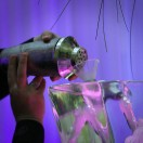 pouring a martini through an ice sculpture